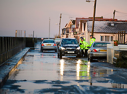 © Licensed to London News Pictures. 13/01/2017. Jaywick, UK. Police officers speak to local residents, along the seafront at Jaywick, Essex, where homes were expected to evacuated due to the threat of flooding in low-lying areas . Photo credit: Ben Cawthra/LNP
