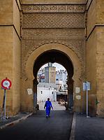 CASABLANCA, MOROCCO - CIRCA APRIL 2017: Woman walking over one of the entrances of the Medina in  Casablanca