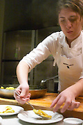 Putting the fired apples on the plates The Dolly Irigoyen - famous chef and TV presenter - private restaurant, Buenos Aires Argentina, South America Espacio Dolli