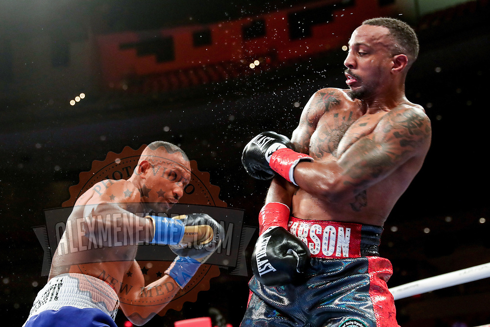HOLLYWOOD, FL - APRIL 17: Carlos Gongora (L) punches Christopher Pearson during the IBO World Super Middleweight title fight at Seminole Hard Rock Hotel & Casino on April 17, 2021 in Hollywood, Florida. (Photo by Alex Menendez/Getty Images) *** Local Caption *** Carlos Gongora; Christopher Pearson