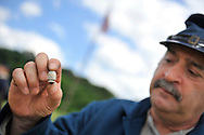 Old Bethpage, New York, USA - July 21, 2012: GENE MONGELLO of Levittown, NY, holds a cleaner bullet from Civil War era - a bullet coated with zinc and thought to help clean rifle barrels - at re-creation of Camp Scott, a Union Army training camp, at Old Bethpage Village Restoration, to commemorate 150th Anniversary of American Civil War, on Saturday, July 21, 2012.