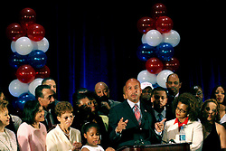 April 22nd, 2006. New Orleans, Louisiana. Voting day. Mayor Ray Nagin speaks to supporters after securing a run off with opponent Mitch Landrieu. Nagin's daughter Tianna (7 yrs) at left and his wife Seletha to the right.<br /> Photo; Charlie Varley/varleypix.com