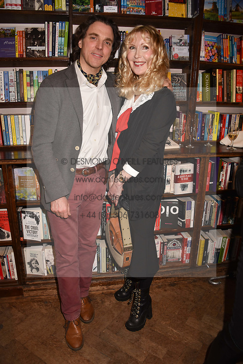 Sacha Newley and Basia Briggs at a party to celebrate the publication of Saving The World by Paola Diana at Daunt Books, Marylebone, London England. 2 May 2018.