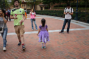 A girl wearing a princess dress walks through Walt Disney Co.s Shanghai Disneyland theme park  towards the iconic castle during a trial run ahead of its official opening, in Shanghai, China, on Wednesday, June 8, 2016. The $5.5 billion Shanghai Disneyland is one  of the most profitable Disney ventures in the world and the first theme park on mainland China.