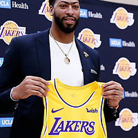 EL SEGUNDO, CA - JUL 13: Anthony Davis shows his Lakers jersey next to General Manager Rob Pelinka and Head Coach Frank Vogel during a press conference on July 13, 2019 at the UCLA Health Training Center, in El Segundo, California.