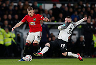 Scott McTominay of Manchester United tackled by Wayne Rooney of Derby County during the FA Cup match at the Pride Park Stadium, Derby. Picture date: 5th March 2020. Picture credit should read: Darren Staples/Sportimage