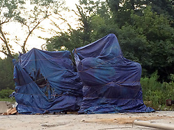 August 17, 2017 - Baltimore, MD, USA - A day after four confederate monuments were removed from public spaces in Baltimore, they sit tarped in a city-owned lot awaiting their final destination. (Credit Image: © Colin Campbell/TNS via ZUMA Wire)
