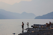 Father and son fishing on Slocan Lake, New Denver, Slocan Valley, West Kootenay, British Columbia, Canada