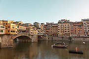 FLORENCE: a bass player on Arno river, Ponte Vecchio