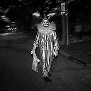 Man dressed as a clown in New Orleans on Halloween.