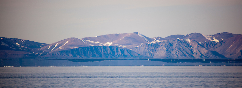 Fata Morgana, or superior mirage in front of Ellesmere Island, seen from the west coast of Arctic Greenland, in Nares Strait, near Petermann Glacier