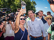 13 AUGUST 2019 - DES MOINES, IOWA: PETE BUTTIGIEG poses for a selfie with a supporter at the Iowa State Fair. Buttigieg, the Mayor of South Bend, Indiana, is running to be the Democratic nominee for the US presidency. He spoke at the Des Moines Register Political Soap Box at the Iowa State Fair and then toured the fairgrounds. Iowa has the first event of the presidential selection cycle. The Iowa Caucuses are February 3, 2020.               PHOTO BY JACK KURTZ