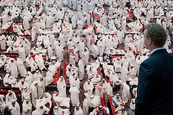 © Licensed to London News Pictures. 14/06/2013. London, UK. A Sothebys employee views 'Kuwait Stock Exchange II' (2008, est. GB£400,000-600,000), a photograph taken by artist Andreas Gursky, at the press view for a Sotheby's auction in London today (14/06/2013). The Contemporary Art Evening Sale takes place on the 26th of June 2013 at Sotherby's New Bond Street premises.  Photo credit: Matt Cetti-Roberts/LNP