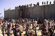 Getting water from Eeika Biiyaha, a mineral water factory tank in Mogadishu, the war-torn capital of Somalia. March 1992.