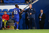 Junior Hoilett of Cardiff city (33) shakes hands with Cardiff city manager Neil Warnock as he is replaced. EFL Skybet championship match, Cardiff city v Sheffield Utd at the Cardiff City Stadium in Cardiff, South Wales on Tuesday 15th August 2017.<br /> pic by Andrew Orchard, Andrew Orchard sports photography.