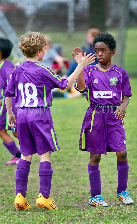 29 March 2015. New Orleans, Louisiana.<br /> U9 New Orleans Jesters Elites, Purple team play U10 Slidell. Jesters take a 4-1 win in a great game.<br /> Photo; Charlie Varley/varleypix.com