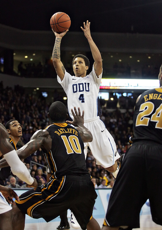 Dec 30, 2011; Norfolk, VA, USA; Old Dominion Monarchs guard Breon Key (10) shoots the ball over Missouri Tigers forward Ricardo Ratliffe (10) at the Ted Constant Convocation Center. Mandatory Credit: Peter Casey-US PRESSWIRE