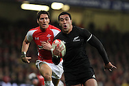 Mils Muliaina of New Zealand makes a break to score his tryInvesco Perpetual match, Wales v New Zealand at the Millennium stadium in Cardiff on Sat 27th Nov 2010.  pic by Andrew Orchard, Andrew Orchard sports photography,