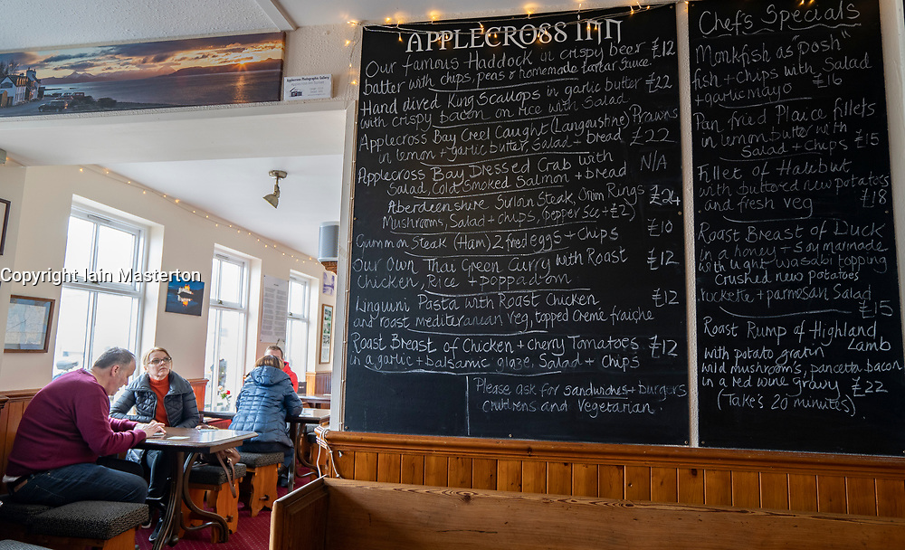Menu blackboard in Applecross Inn on the North Coast 500 scenic driving route in northern Scotland, UK