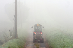 © Licensed to London News Pictures. 16/09/2014<br /> A foggy morning today(16.09.2014)<br />  Foggy driving conditions this morning for this farmer on his way to work in Crockenhill Lane,Crockenhill,Kent.<br /> (Byline:Grant Falvey/LNP)