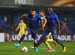 December 7, 2017 - Vila-Real, Castellon, Spain - Mario Gonzalez of Villarreal CF and Eytan Tibi  and Jean Sylvain Babin of Maccabi Tel Aviv during the Europa League match between Villarreal CF and Maccabi Tel Aviv at Estadio de la Ceramica on december 7, 2017 in Vila-real, Spain. (Credit Image: © Maria Jose Segovia/NurPhoto via ZUMA Press)