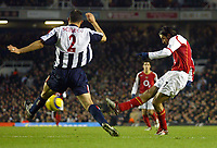 20/11/2004 - FA Barclays Premiership - Arsenal v  - West Bromich Albion - HIghbury Stadium, London<br />Arsenal's Robert Pires scores the opening goal around the outstretched lunge of West Bromich Albion's Ricardo Scimeca<br />Photo:Jed Leicester/Back Page Images