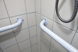 Close up of a grab rail in a shower,