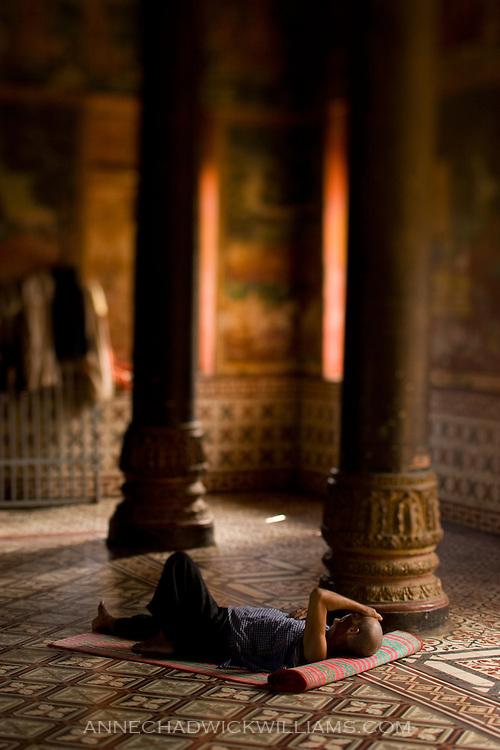 A man naps in a wat in Phnom Penh, Cambodia.