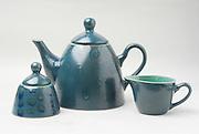 Matching Tea pot, milk jug and sugar bowl, on white background