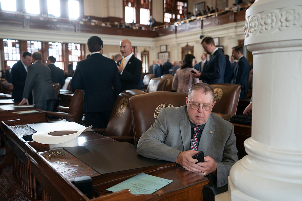 State Rep. Cecil Bell, R-Magnolia, pauses on the House floor to make a phone call during the first day of the speical session on July 8, 2021.
