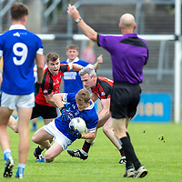Cratloe's Podge Collins is tackled by Clondegad's Tony Kelly and Barry Toner