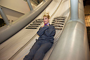 CRAWLEY, WEST SUSSEX, UK, OCTOBER 27TH 2011. Journalist / writer Andrea Sachs tests the emergency exit slide during research on a story about Virgin Atlantic air stewardess and steward training at The Base training facility. (Photo by Mike Kemp for The Washington Post)