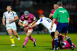 Exeter Chiefs Number 8 (#8) Richard Baxter is tackled by Clermont replacement (#17) Vincent Debaty during the second half of the match - Photo mandatory by-line: Rogan Thomson/JMP - Tel: Mobile: 07966 386802 20/10/2012 - SPORT - RUGBY - Sandy Park Stadium - Exeter. Exeter Chiefs v ASM Clermont Auvergne - Heineken Cup Round 2
