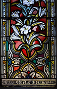 Stained glass window ornamental floral pattern lilies circa 1880 Ward and Hughes, Wilsford church, Wiltshire, England, UK