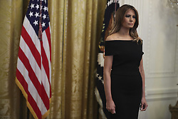 First Lady Melania Trump looks on as President Donald Trump speaks during a Hanukkah reception in the East Room of the White House on December 6, 2018 in Washington, DC. Behind Trump, Vice President Mike Pence. (Photo by Oliver Contreras/SIPA USA)