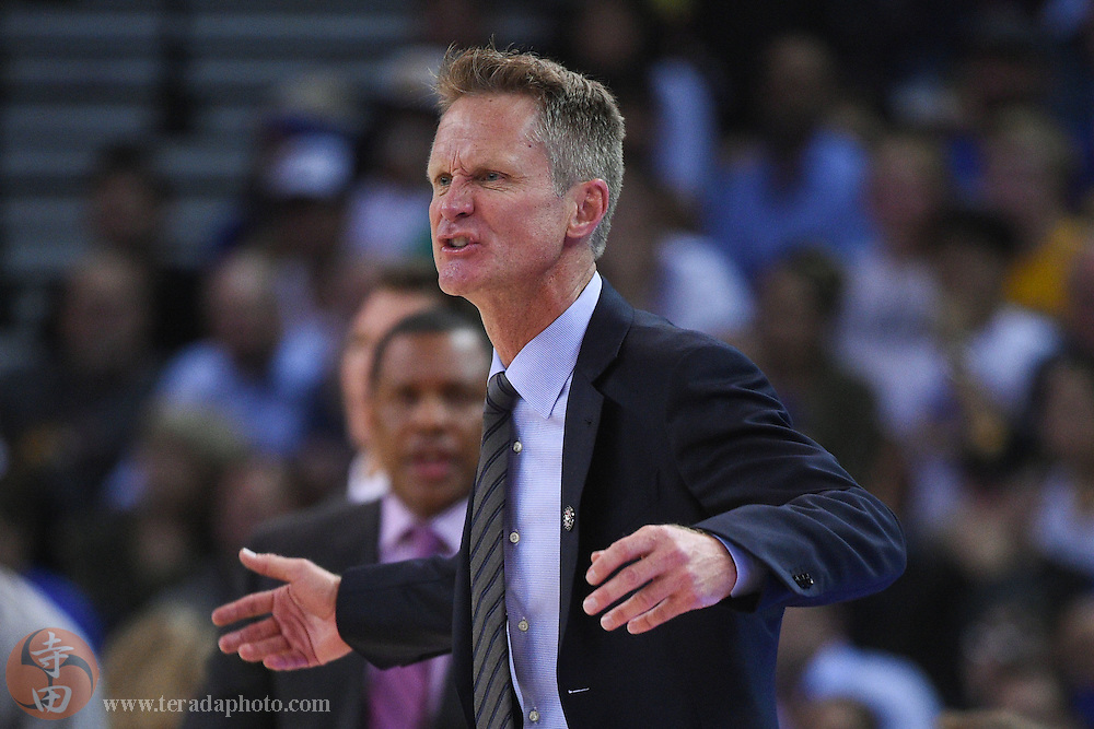 November 5, 2014; Oakland, CA, USA; Golden State Warriors head coach Steve Kerr reacts after receiving a technical foul during the third quarter against the Los Angeles Clippers at Oracle Arena. The Warriors defeated the Clippers 121-104.