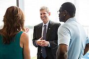 """Frisco ISD Superintendent Dr. Jeremy Lyon visits with Dallas Cowboys Executive Vice President / Chief Brand Officer Charlotte Jones Anderson and NFL Hall of Fame inductee Michael Irvin in the new Dallas Cowboys headquarters in Frisco, Texas on August 23, 2016. """"CREDIT: Cooper Neill for The Wall Street Journal""""<br /> TX HS Football sponsorships"""