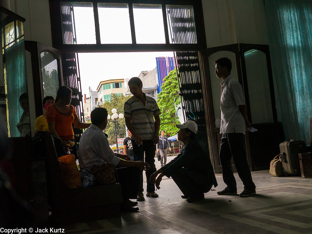 06 APRIL 2012 - HAI PHONG, VIETNAM: Passengers for the return trip to Hanoi in the Hai Phong Train station. The Hanoi to Hai Phong Express Train runs several times a day between Long Bien Station in Hanoi and the Hai Phong Station. Hanoi is the capital of Vietnam and Hai Phong is the 4th largest city in Vietnam. Hai Phong is the principal industrial port in the northern part of Vietnam. It was heavily bombed and mined during the American War (what Americans call the Vietnam War).   PHOTO BY JACK KURTZ