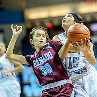 Ganado Hornet Chasity Gorman (30), left, and Window Rock Scout Vanessa James (15) tie up during the Tournament of Champions at the Window Rock Scout Event Center in Fort Defiance Wednesday