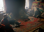 Opium users inside Ooroon Boi's house, son of the Khan. Winter expedition through the Wakhan Corridor and into the Afghan Pamir mountains, to document the life of the Afghan Kyrgyz tribe. January/February 2008. Afghanistan