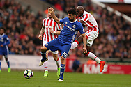 Diego Costa of Chelsea breaks away from a tackle from Bruno Martins Indi of Stoke city (r).  Premier league match, Stoke City v Chelsea at the Bet365 Stadium in Stoke on Trent, Staffs on Saturday 18th March 2017.<br /> pic by Andrew Orchard, Andrew Orchard sports photography.