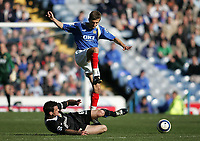 Photo: Lee Earle.<br /> Portsmouth v Blackburn Rovers. The Barclays Premiership. 08/04/2006. Blackburn's Ryan Nelsen (L) slides in on Gary O'Neil.