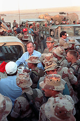 Nov. 22, 1990 - SAUDI ARABIA - US President George Bush leans on the hood of a Humvee as he talks to Marines during a Thanksgiving Day visit to a desert encampment November 22, 1990 in Saudi Arabia.  The President is visiting U.S. troops in Saudi Arabia for Operation Desert Shield. (Credit Image: © Cw02 Ed Bailey/Planet Pix via ZUMA Wire)
