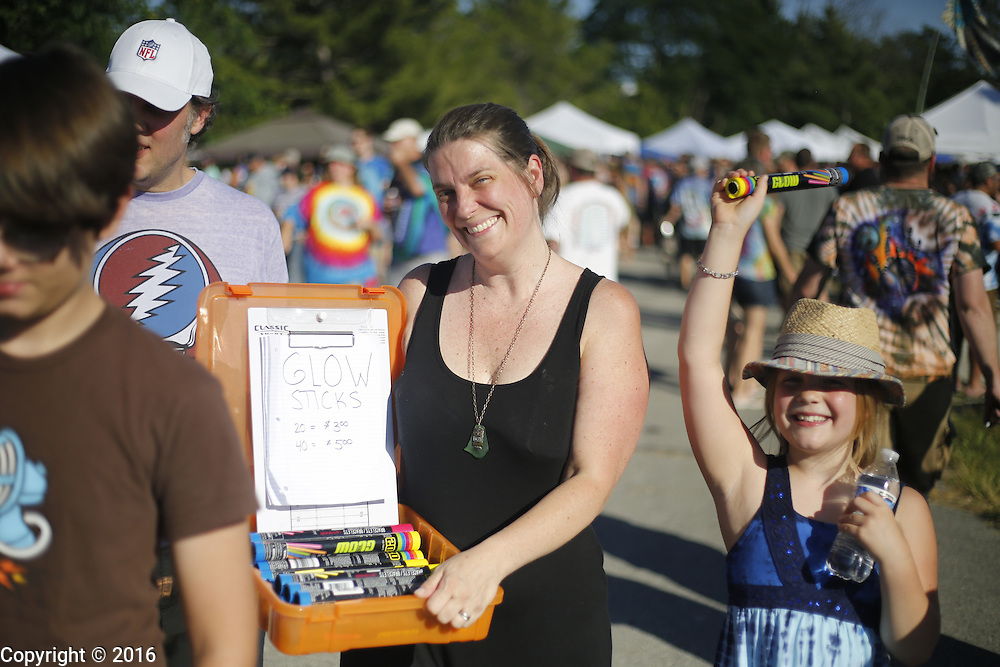 """06212016 - Noblesville, Indiana, USA: A Dead and Company fan sells glow sticks on """"Shakedown Street"""" in the parking lot of Klipsch Music Center (Deer Creek) before members of the Grateful Dead perform as Dead and Company. The Grateful Dead's final show at  Deer Creek in July 1995 was marred by over a thousand fans crashing the gates leading to the next day's show being canceled. Grateful Dead guitarist Jerry Garcia died a few weeks later. (Jeremy Hogan/Polaris)"""
