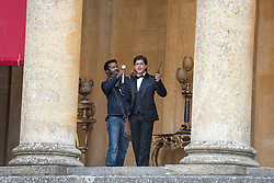 © Licensed to London News Pictures. 27/03/2015. Shah Rukh Khan (pictured in suit) filming for his new Bollywood production 'FAN' at Blenheim Palace in Woodstock, Oxfordshire, UK on March 27, 2015. Shah Rukh Khan (Also known as SRK) has appeared in more than 80 Bollywood films and is considered to be one of the worlds biggest film and television stars. Photo credit: Mark Hemsworth/LNP