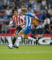 Photo: Peter Phillips.<br /> Wigan Athletic v Sunderland. The Barclays Premiership.<br /> 27/08/2005.<br /> Wigans Jimmy Bullard has run at the Sunderland defence watched by Dean Whitehead