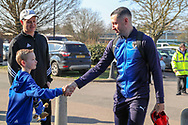 AFC Wimbledon midfielder Anthony Hartigan (8) arriving and shaking young fans hand during the EFL Sky Bet League 1 match between AFC Wimbledon and Charlton Athletic at the Cherry Red Records Stadium, Kingston, England on 23 February 2019.