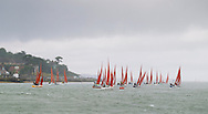 A squall hits the Squib fleet on the opening day of Aberdeen Asset Management Cowes Week. The event began in in 1826 and plays a key part in the British sporting summer 'season'. It now stages up to 40 daily races for around 1,000 boats and is the largest sailing regatta of its kind in the world with 8,500 sailors competing.<br /> Picture date Saturday 2nd August, 2014.<br /> Picture by Christopher Ison. Contact +447544 044177 chris@christopherison.com