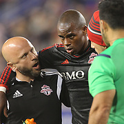 Jackson, Toronto FC,  is helped off the pitch after clashing heads with Jamison Olave, New York Red Bulls, while challenging for a ball during the New York Red Bulls Vs Toronto FC, Major League Soccer regular season match at Red Bull Arena, Harrison, New Jersey. USA. 11th October 2014. Photo Tim Clayton