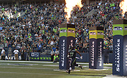 Aug 25, 2017; Seattle, WA, USA; dSeattle Seahawks running back Eddie Lacy (27) runs onto the field through flames during a NFL football game at CenturyLink Field.